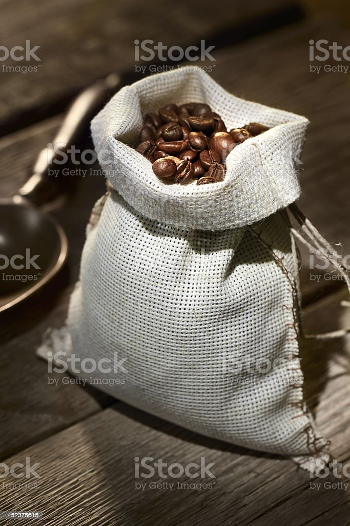 Coffee beans in the burlap sack royalty-free stock photo