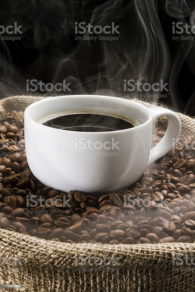 Coffee beans in the sack with cup of coffee. royalty-free stock photo
