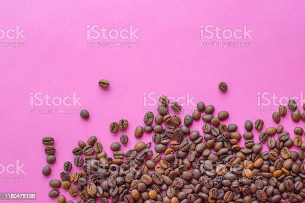 Coffee beans isolated on pink background with copy space for text picture id1180475138?b=1&k=6&m=1180475138&s=612x612&h=rmkoicrtcdpnjt oa2 z4y6pfylzzctuvbvxan62xzw=