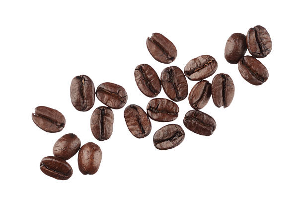 coffee beans isolated on white background close up - coffee beans stock photos and pictures