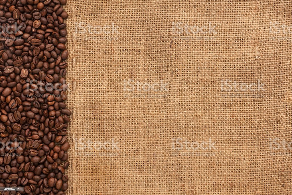Coffee beans lying on sackcloth stock photo