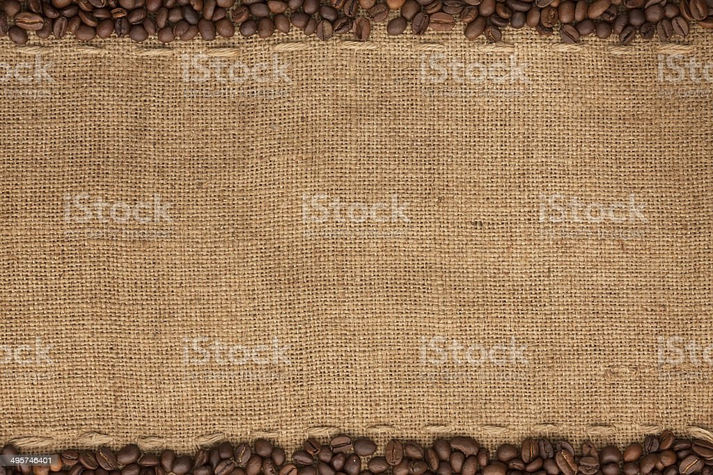Coffee beans lying on sackcloth stock photo