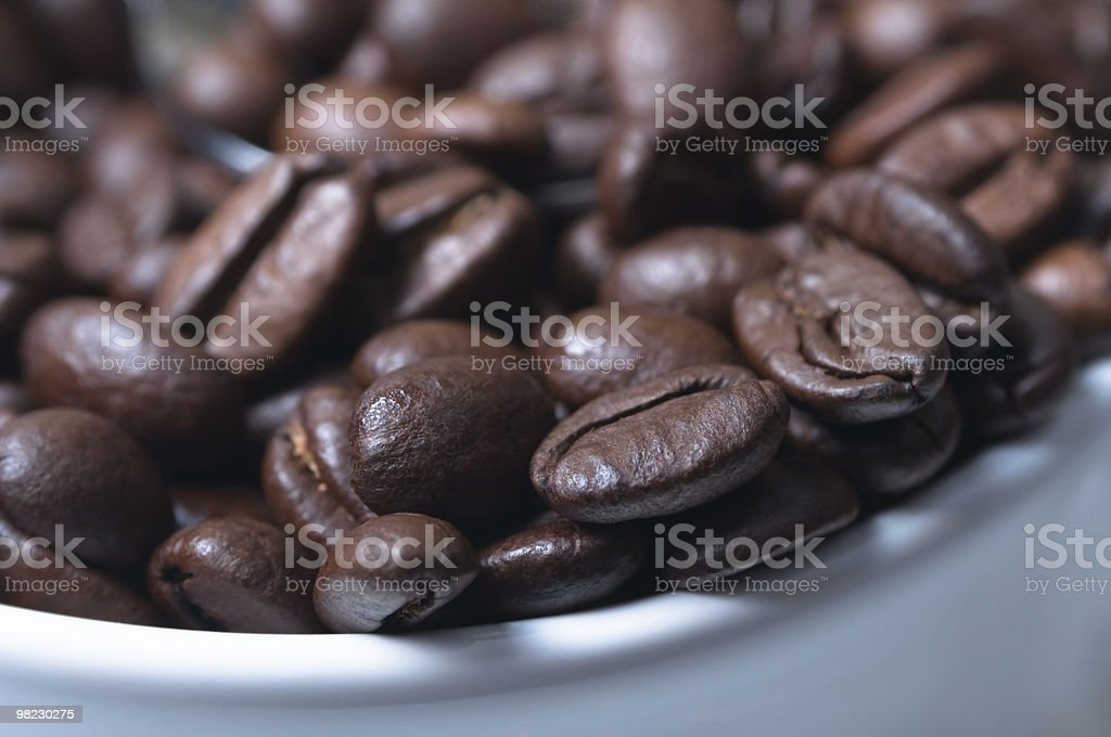 Coffee Beans Macro in Cup royalty-free stock photo