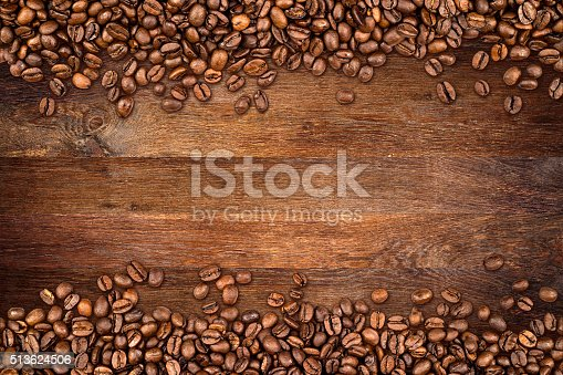 istock coffee beans old oak background 513624506