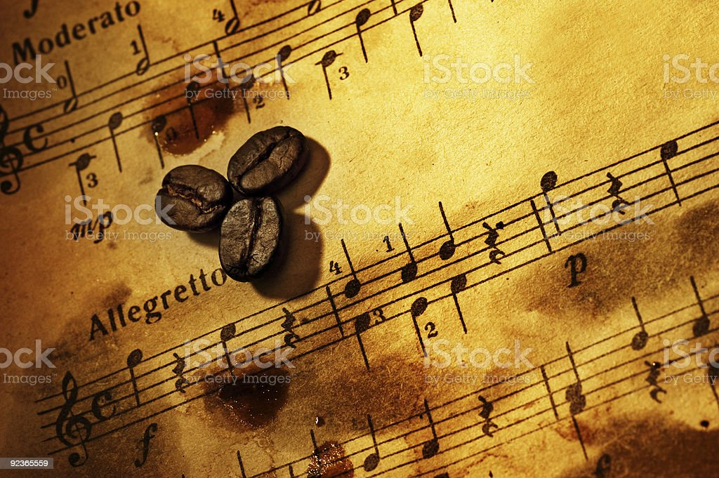 Coffee beans on a grungy musical background royalty-free stock photo
