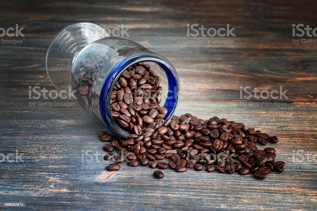 Coffee beans on a wooden table. royalty-free stock photo