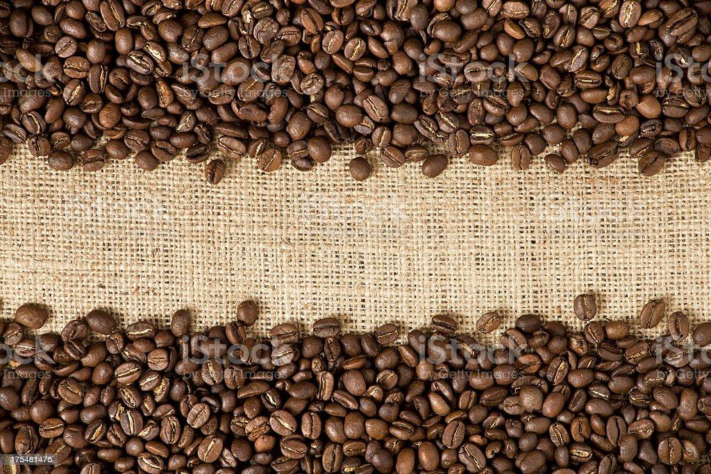 Coffee beans on burlap stock photo