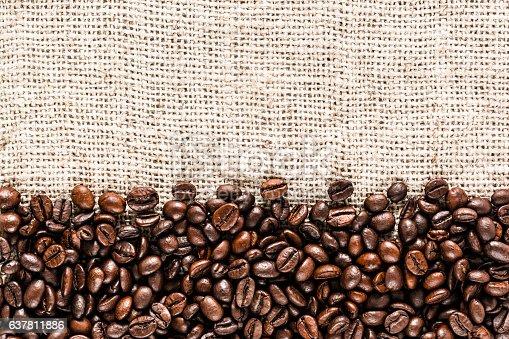 istock Coffee beans on burlap 637811886
