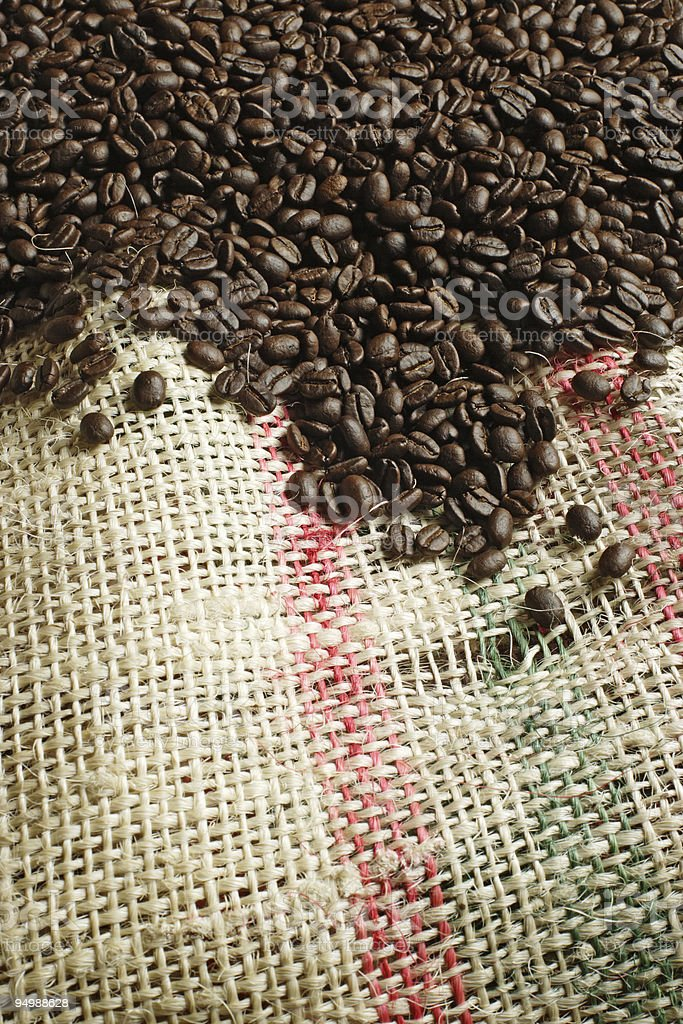 Coffee beans on canvas sack royalty-free stock photo