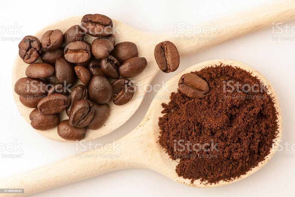 coffee beans on cooking spoon stock photo