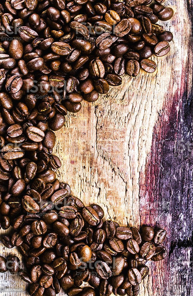 Coffee beans on grunge old wooden background. royalty-free stock photo