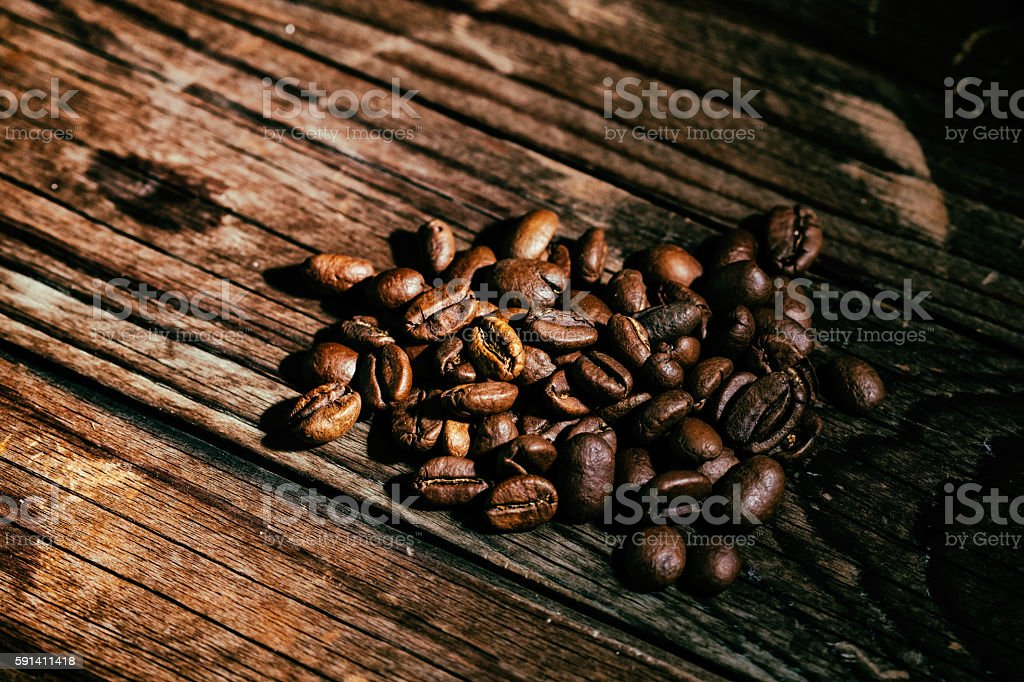 Coffee Beans on old wooden table. stock photo