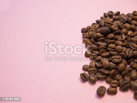Coffee beans on pink background copy space coral trend