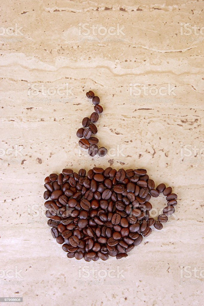 Coffee beans on the grunge background royalty-free stock photo