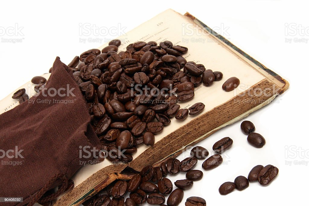coffee  beans on the old book royalty-free stock photo