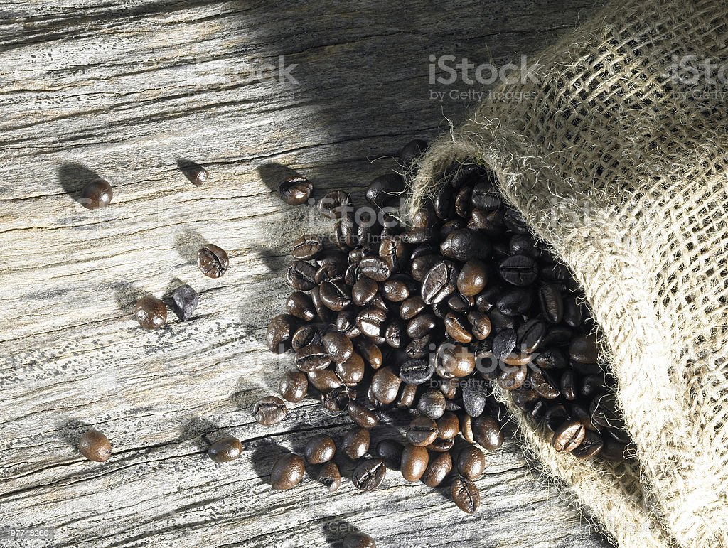 coffee beans on weathered wood royalty-free stock photo