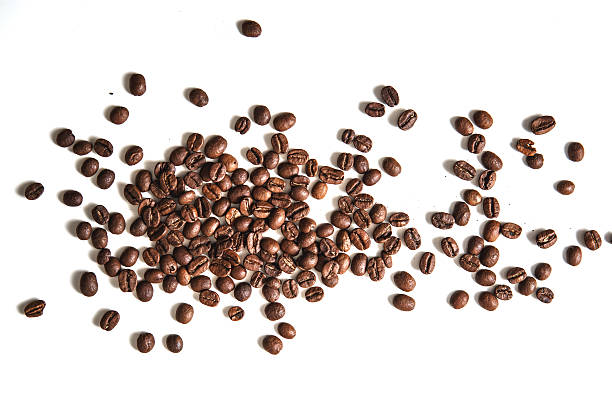 coffee beans on white background - coffee beans stock photos and pictures