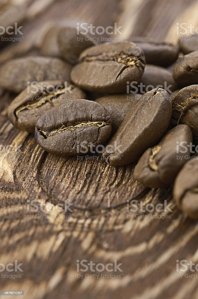 Coffee beans on wood background royalty-free stock photo