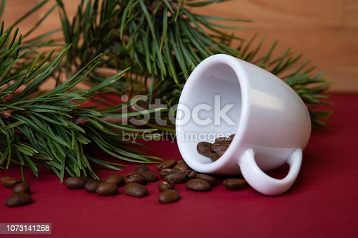 Christmas decoration with cup and roasted coffee beans.