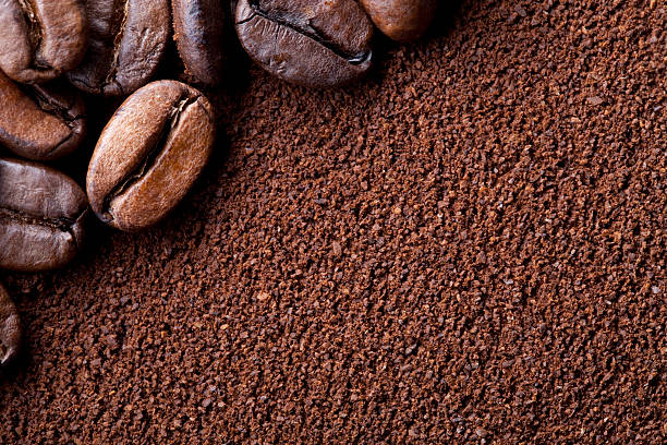 Coffee beans Coffee beans and ground coffee.To see more Coffee images click on the link below: grinding stock pictures, royalty-free photos & images