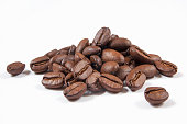 Heap of coffee beans isolated on white.