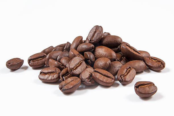 Coffee Beans Heap of coffee beans isolated on white. caffeine stock pictures, royalty-free photos & images