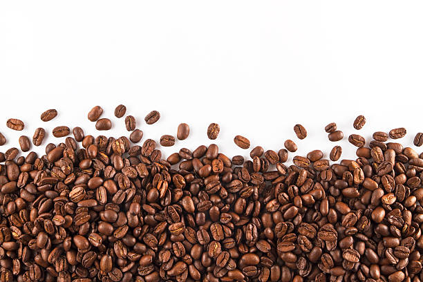 Coffee Beans Coffee beans on white background. roasted coffee bean stock pictures, royalty-free photos & images
