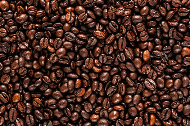 Coffee beans Coffee beans background caffeine stock pictures, royalty-free photos & images
