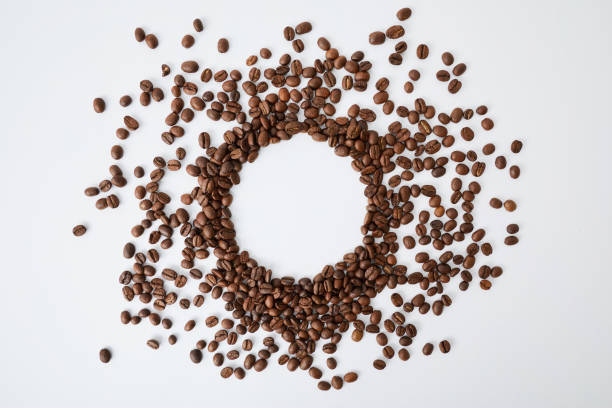 Coffee Beans Coffee Beans on white spit roasted stock pictures, royalty-free photos & images