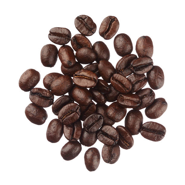Coffee beans pile isolated on white background close up stock photo