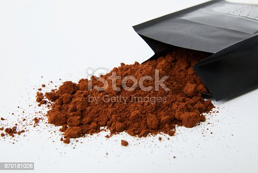 867484488 istock photo Coffee beans spilling out from the package 870181026