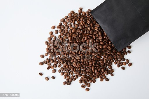 istock Coffee beans spilling out from the package 870181084