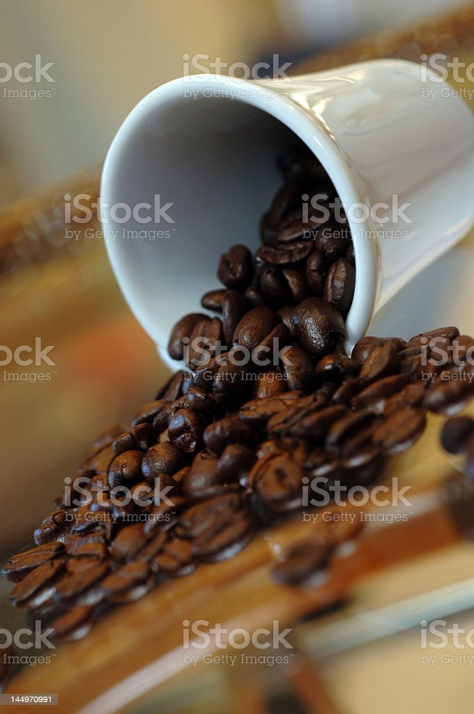 Coffee beans strewed over a surface royalty-free stock photo