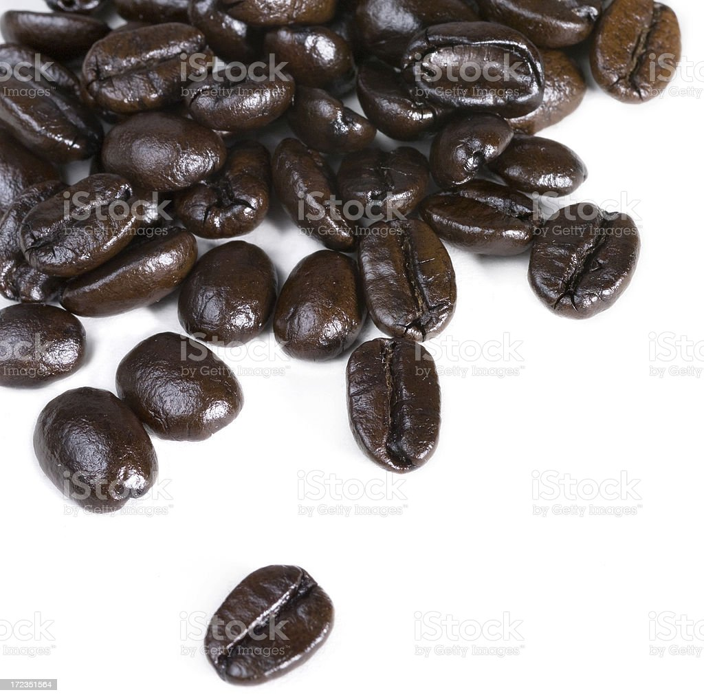 Coffee beans strewn on white royalty-free stock photo