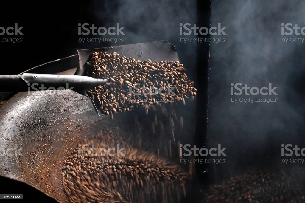 Coffee beans that are being roasted  stock photo