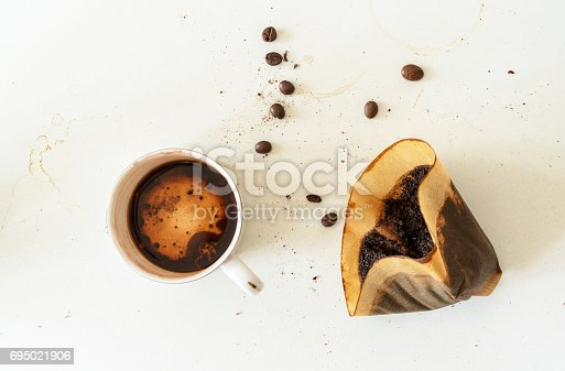 coffee beans, used filter paper and residual in coffee cup