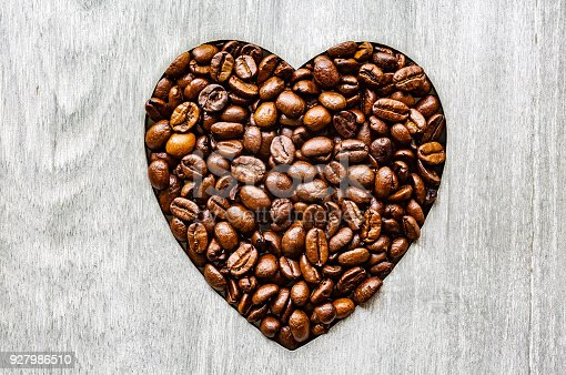 istock Coffee beans with a heart. Love or passion concept . 927986510
