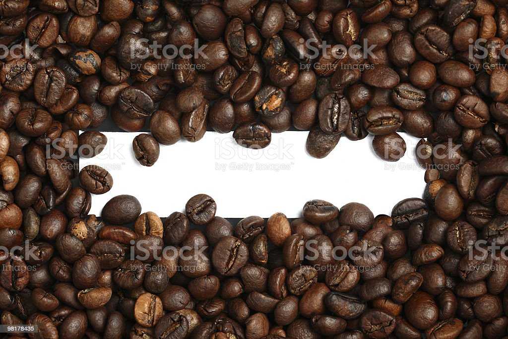 Coffee beans with blank white label in the middle royalty-free stock photo