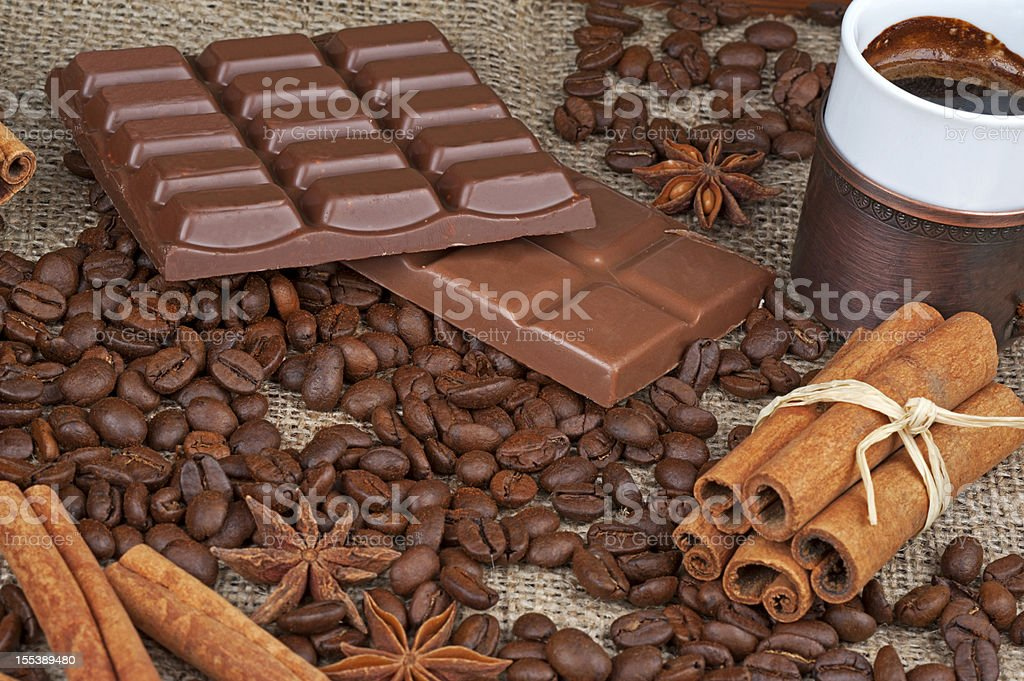 Coffee beans with cinnamon sticks stock photo