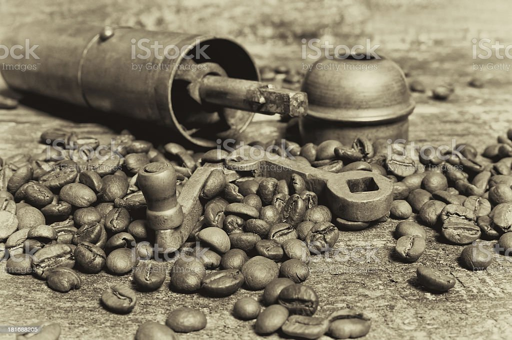 Coffee beans with grinder on wooden table. royalty-free stock photo