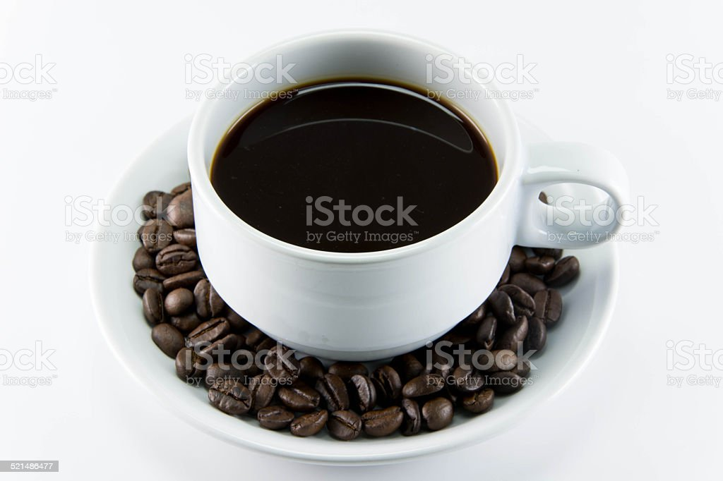 Coffee beans with leaves on white background stock photo