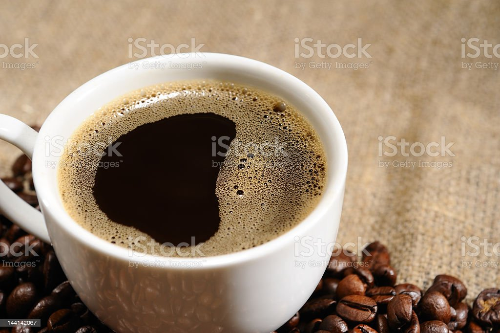 coffee beans with mug on a rough sacking royalty-free stock photo