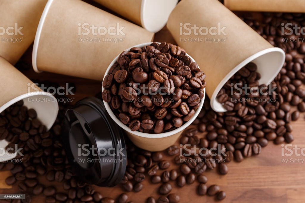 Coffee beans with paper cups royalty-free stock photo