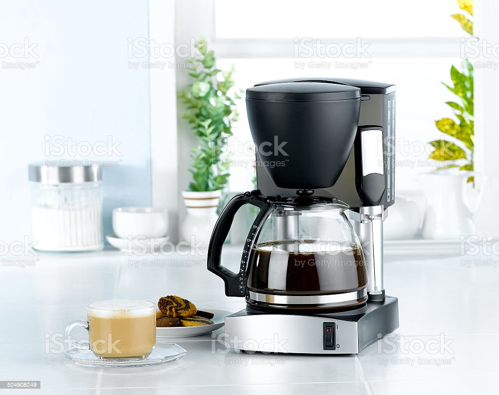 Coffee blender and boiler machine in kitchen interior