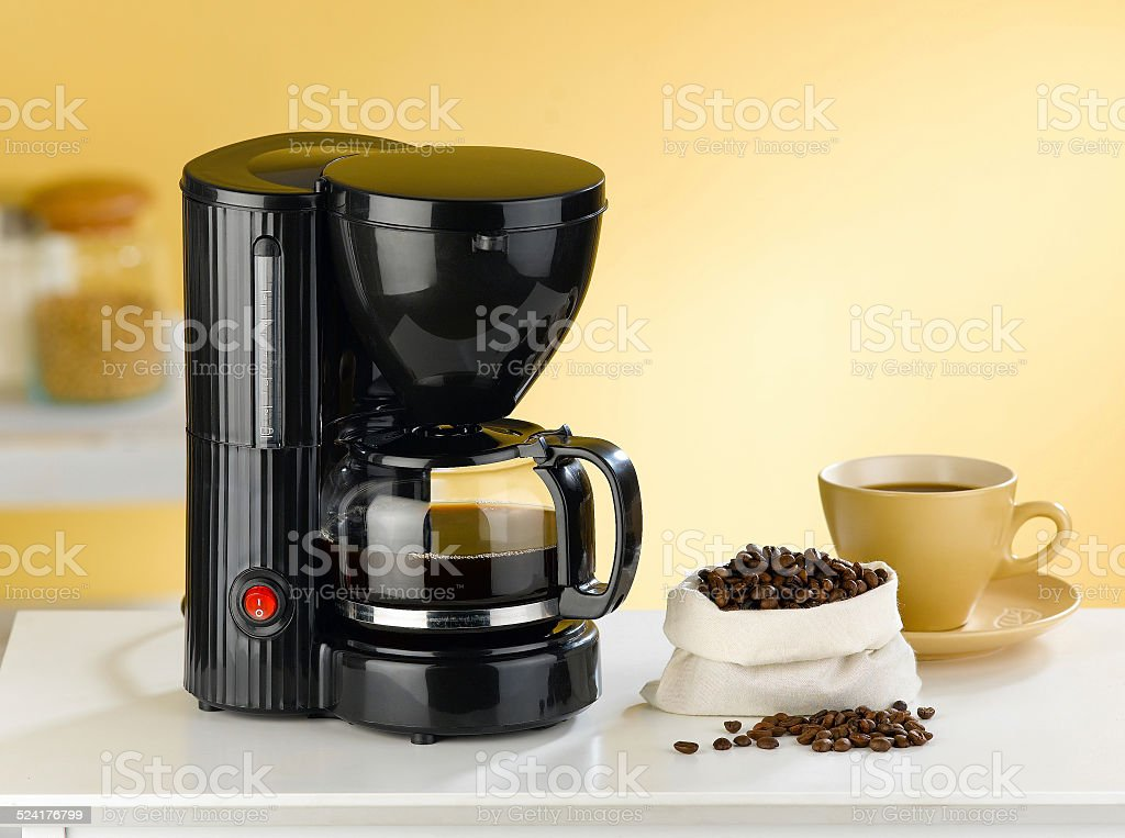 Coffee blender and boiler with coffee seeds in a kitchen stock photo