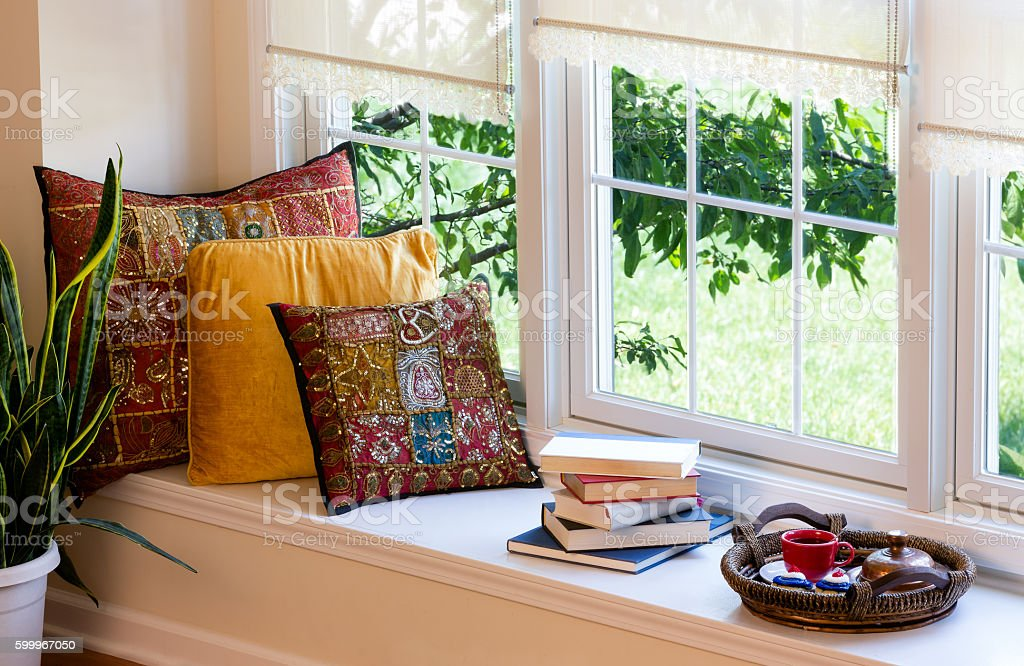 Coffee, Books and Pillows at the Reading Corner stock photo