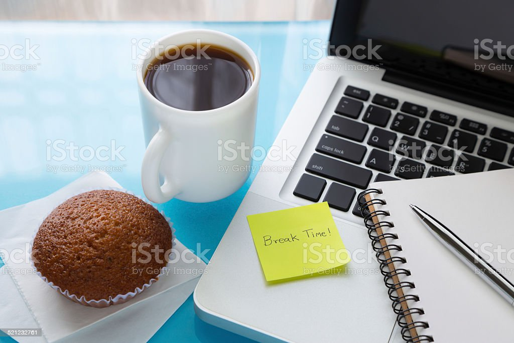 Coffee break and paper note with Break Time message stock photo
