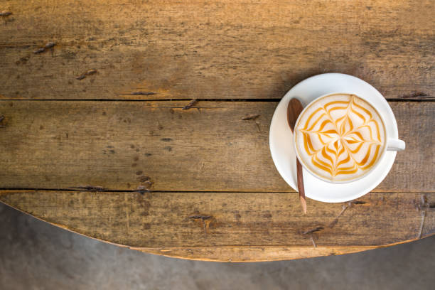 coffee break at retro style coffee shop,top view. - coffee table imagens e fotografias de stock