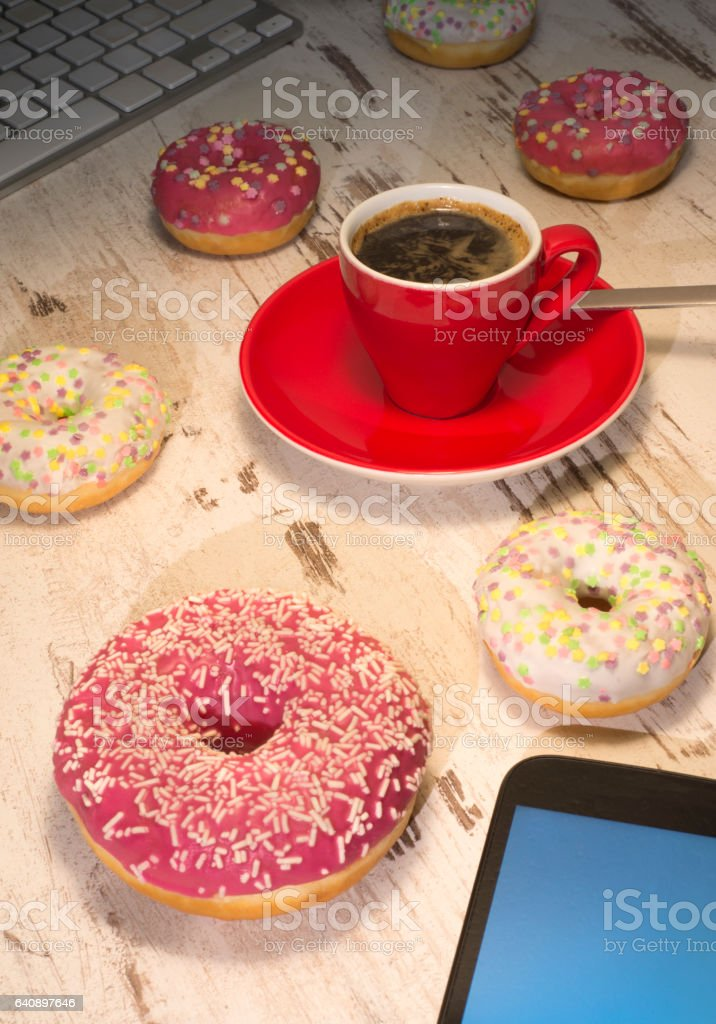 Coffee break at work with donuts stock photo