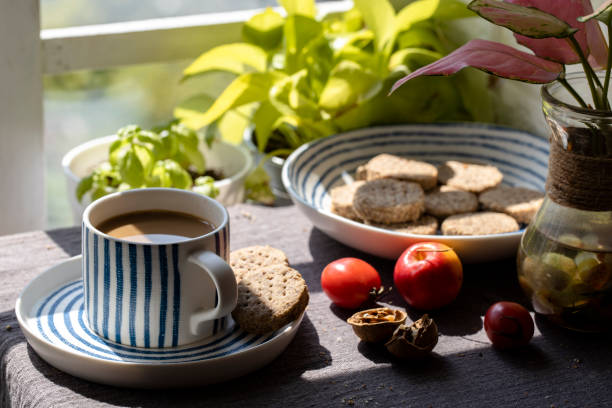 coffee break: coffee and home baked whole wheat biscuits in sunlight